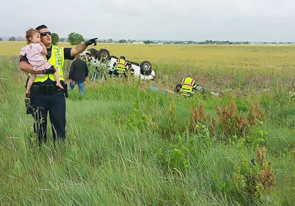 Police_Officer_Distracts_Little_Girl_After_Father_Dies_In_Tragic_Car_Accident