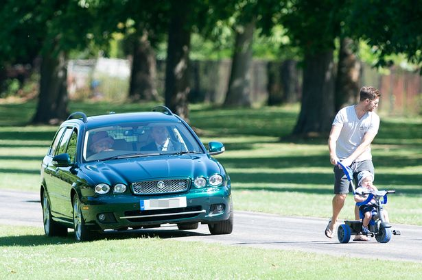 Young_family_stunned_as_impatient_Queen_caught_driving_on_the_grass_to_get_past_them1