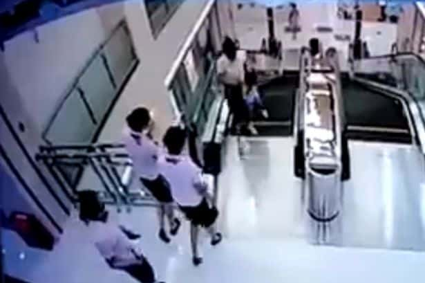 Mother_throws_son_to_safety_before_falling_to_death_in_escalator_horror
