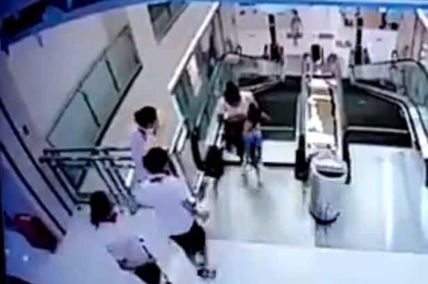 Mother_throws_son_to_safety_before_falling_to_death_in_escalator_horror1