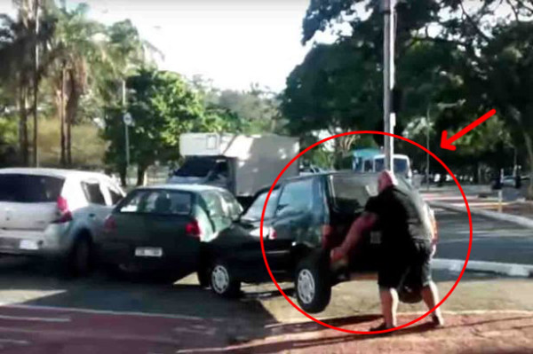 Watch_incredible_moment_angry_cyclist_lifts_CAR_out_of_bike_lane_as_pedestrians_cheer_wildly