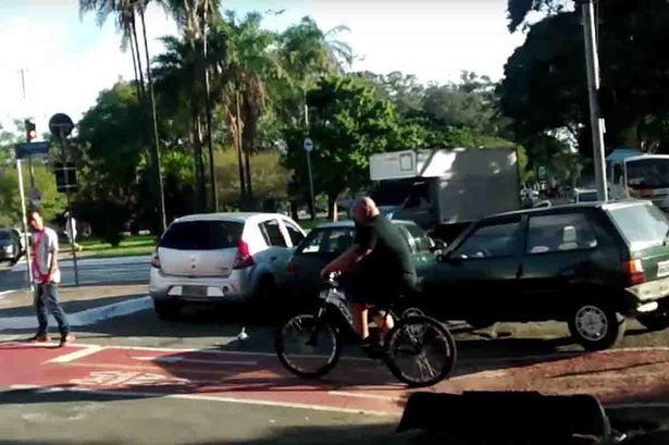 Watch_incredible_moment_angry_cyclist_lifts_CAR_out_of_bike_lane_as_pedestrians_cheer_wildly1