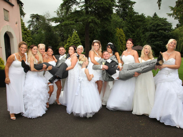 This_Gay_Couple_Asked_All_Their_Bridesmaids_To_Wear_Wedding_Dresses