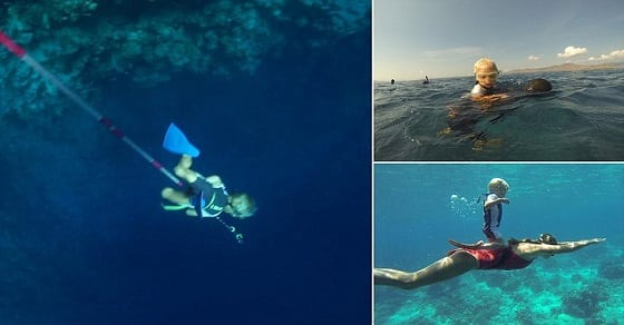 Fedor, aged three, using a rope to freedive. STUNNING video footage what could be the worldís youngest freediver learning his trade without any air supply from the age of TWO. The video and pictures shows the young boy, who has been training since the age of two, hold onto his dadís back as he dives under the surface of the water before he emerges for air twenty seconds later. The incredible footage also shows the kid, called Fedor who is the son of a pro-freediver repeating the trick on his mumís back as she swims underwater and aged three, using a rope to pull himself deep underwater before rising back above the surface when he can no longer hold his breath. The video was taken by professional freediver Alexey Molchanov (29) from Moscow, Russia as he was in Dahab, Blue Hole, Egypt.  It shows three-year-old Fedor Afonasiev being taught how to freedive by his parents, who are friends of Alexeyís and instructors in his Freediving Federation education agency.